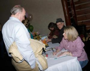 michele spry signing Tom T's Hat Rack