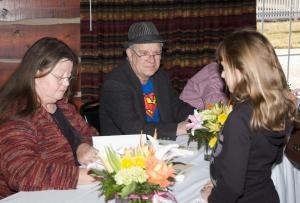 Shot of everyone signing books at Tom T's Hat Rack event