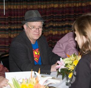 Tom at signing table at Tom T's Hat Rack event