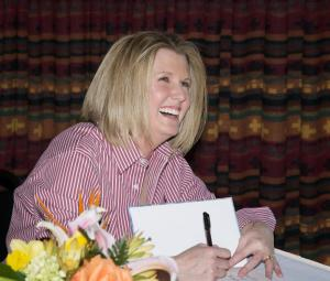 Big smile from Michele Spry at book signing for Tom T's Hat Rack
