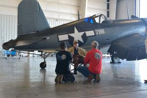 corsair private event_Purdy speaking with two men by plane