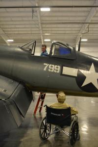 corsair private event_Purdy looking up at man in plane
