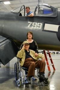 corsair private event_man in plane and woman behind Purdy's wheelchair