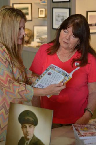 Planes of Fame - August 6, 2016 - Michele showing her book to a woman